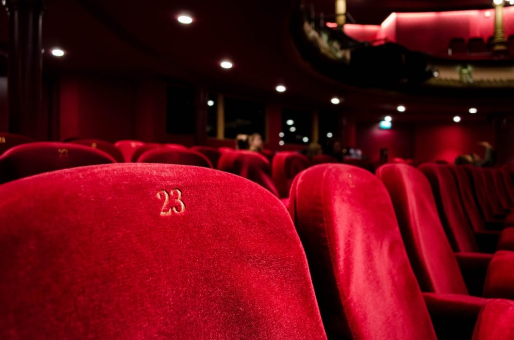 Chairs in a theatre, a hub of arts and culture.