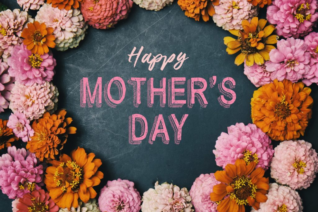 """Chalkboard that says """"Happy Mother's Day"""" with pink and orange flowers"""