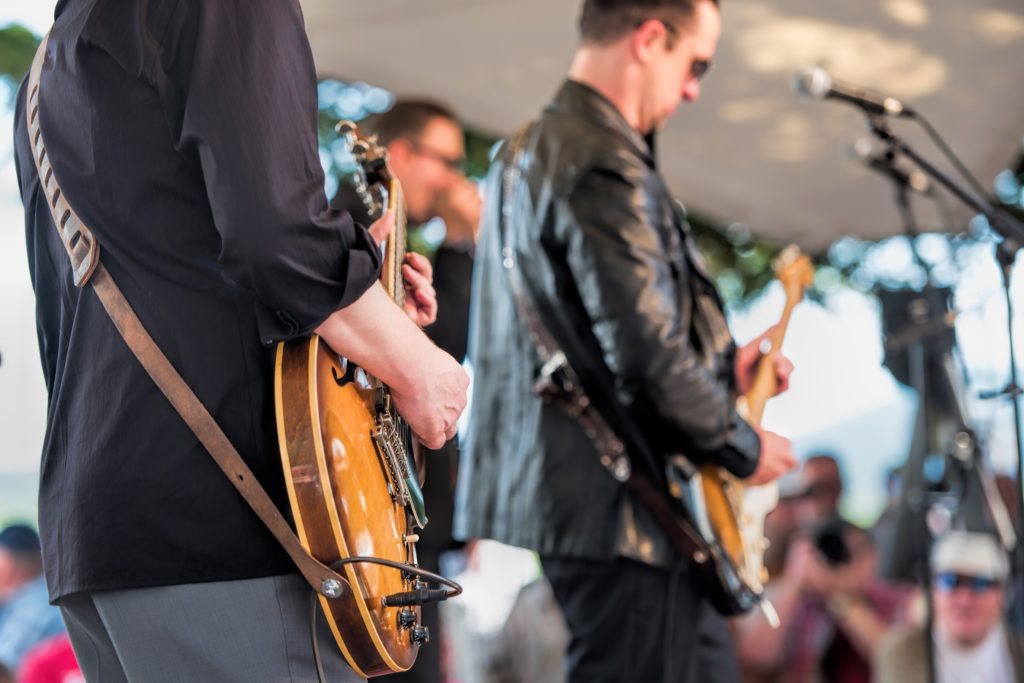 Musicians playing at an outdoor concert