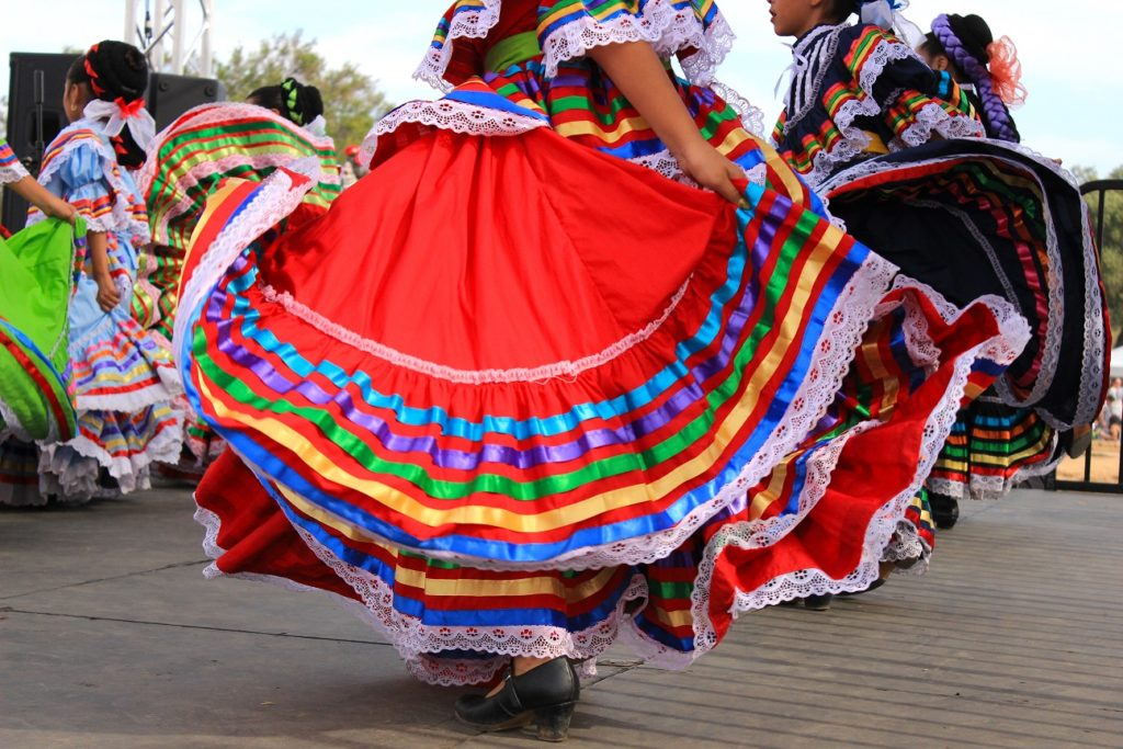 Colorful skirts flying during a dance