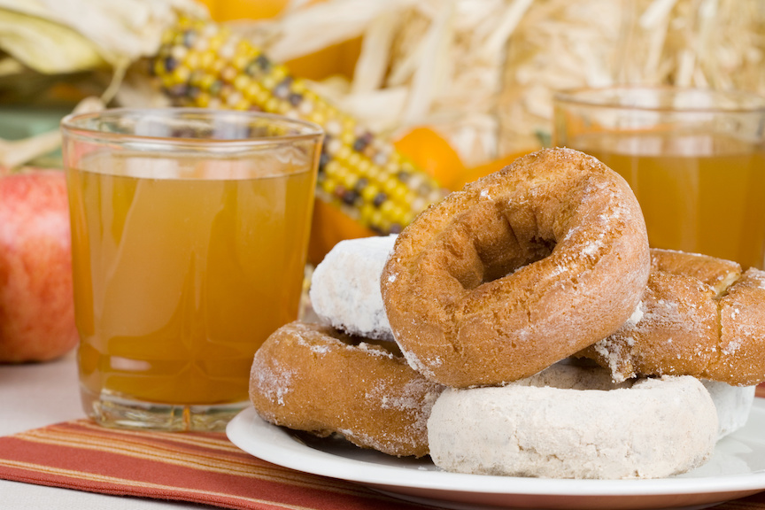 A plate of doughnuts and glass of apple cider to celebrate autumn in October!
