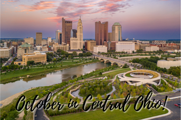 """Downtown Columbus skyline at sunset with the text, """"October in Central Ohio"""""""